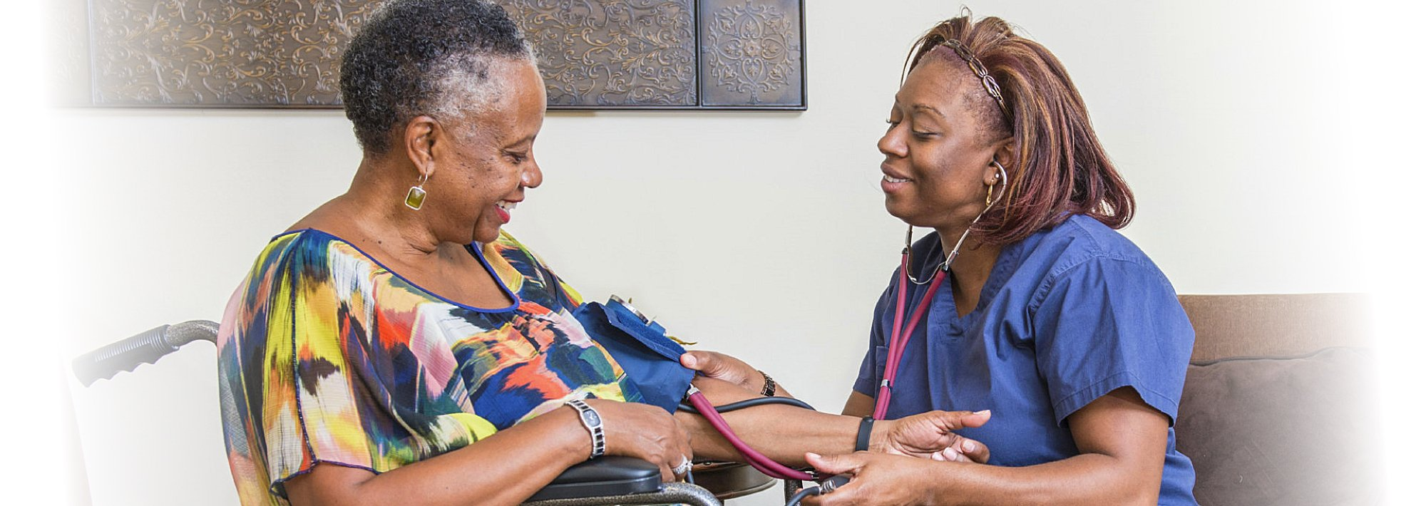 Nurse checking the blood pressure of a female senior